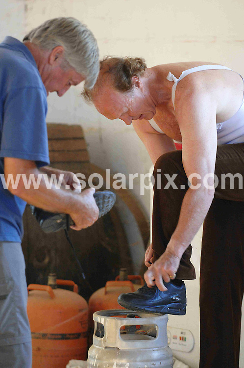 **ALL ROUND EXCLUSIVE  PICTURES FROM SOLARPIX.COM**.**WORLDWIDE SYNDICATION RIGHTS**.Frank Evans  who is 65 yrs old the last British bullfighter who has been fighting bulls in Spain since he was 17 yrs old he retired in 2005  pictured her in training in Chiclana Jerez De La frontera in Cadiz for his comeback...this pic:preparing for practice with helper..JOB REF:6719-CS1         DATE:25_06_08.**MUST CREDIT SOLARPIX.COM OR DOUBLE FEE WILL BE CHARGED* *UNDER NO CIRCUMSTANCES IS THIS IMAGE TO BE REPRODUCED FOR ANY ONLINE EDITION WITHOUT PRIOR PERMISSION*