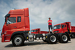 Charles Darbyshire poses with a Dongfeng Industrial Vehicle at the end of the Dongfeng Race Team Official Launch Ceremony & Christening ahead the 2014/15 Volvo Ocean Race on February 26, 2014 in Sanya, China. Photo by Victor Fraile / Power Sport Images