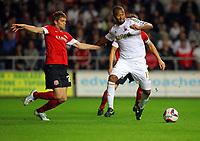 Pictured: Luke Moore of Swansea (R) scoring, while Martin Cranie of Barnsley (L) fails to stop him. Tuesday 28 August 2012<br /> Re: Capital One Cup game, Swansea City FC v Barnsley at the Liberty Stadium, south Wales.