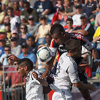 LA Galaxy defender Sean Franklin (5), New England Revolution midfielder Juan Agudelo (10), and LA Galaxy defender Tommy Meyer (21) battle for head ball.  In a Major League Soccer (MLS) match, the New England Revolution (blue) defeated LA Galaxy (white), 5-0, at Gillette Stadium on June 2, 2013.