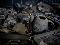 A charred teapot in what used to be someone's kitchen stands destroyed in a burned out residential building in the town of Krasnohorivka. The frontline between Ukrainian government forces and the positions of Russian-backed separatists is closeby.