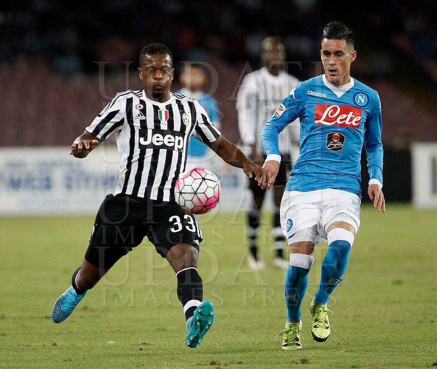 Calcio, Serie A: Napoli vs Juventus. Napoli, stadio San Paolo, 26 settembre 2015. <br /> Juventus' Patrice Evra, left, is challenged by Marek Hamsik during the Italian Serie A football match between Napoli and Juventus at Naple's San Paolo stadium, 26 September 2015.<br /> UPDATE IMAGES PRESS/Isabella Bonotto