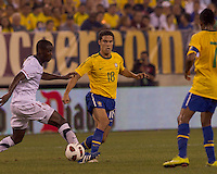 Brazil midfielder Hernanes (18) flips little pass beyond USA midfielder Maurice Edu (19) towards Brazil forward Robinho (7). Brazil  defeated the US men's national team, 2-0, in a friendly at Meadowlands Stadium on August 10, 2010.