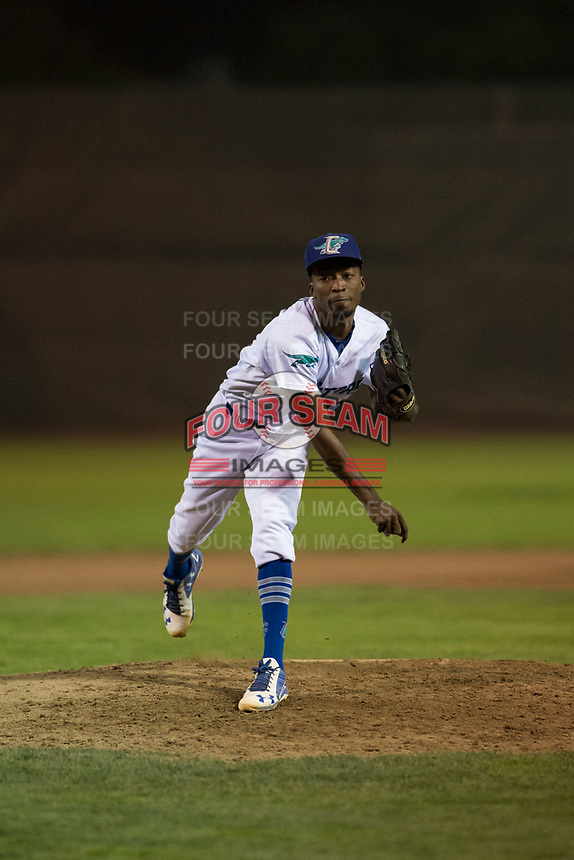 Ogden Raptors relief pitcher Luis Pasen (22) follows through on his delivery during a Pioneer League game against the Great Falls Voyagers at Lindquist Field on August 23, 2018 in Ogden, Utah. The Ogden Raptors defeated the Great Falls Voyagers by a score of 8-7. (Zachary Lucy/Four Seam Images)