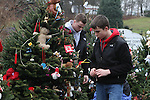 NEWTOWN, CT-17 December 2012-121712LW10 - Visitors place decorations on evergreen memorials near the entrance of Sandy Hook Elementary School in Newtown Monday. Laraine Weschler