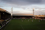 Motherwell 3 Dundee 1, 12/12/2015. Fir Park, Scottish Premiership. Winter sunshine illuminates the first-half action as Motherwell (in amber) play Dundee in a Scottish Premiership fixture at Fir Park. Formed in 1886, the  home side has played at Fir Park since 1895. Motherwell won the match by three goals to one, watched by a crowd of 3512 spectators. Photo by Colin McPherson.