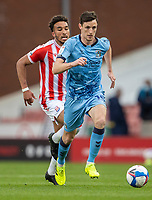21st April 2021; Bet365 Stadium, Stoke, Staffordshire, England; English Football League Championship Football, Stoke City versus Coventry; Dominic Hyam of Coventry City chases a loose ball