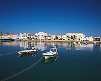 The boat-harbour under a deep blue sky in Faro the capital of the Algarve, Portuga