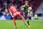 Fabio Coentrao of Sporting CP (R) fights for the ball with Angel Correa of Atletico de Madrid (L) during the UEFA Europa League quarter final leg one match between Atletico Madrid and Sporting CP at Wanda Metropolitano on April 5, 2018 in Madrid, Spain. Photo by Diego Souto / Power Sport Images