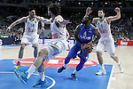 Real Madrid's Gustavo Ayon (l), Sergio Llull (2l) and Felipe Reyes (r) and Maccabi Electra Tel Aviv's Jeremy Pargo (2r) during Euroleague match.March 27,2015. (ALTERPHOTOS/Acero)