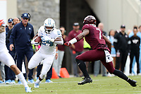 BLACKSBURG, VA - OCTOBER 19: Antonio Williams #24 of the University of North Carolina tries to run past Devon Hunter #7 of Virginia Tech during a game between North Carolina and Virginia Tech at Lane Stadium on October 19, 2019 in Blacksburg, Virginia.
