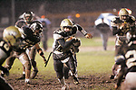 ANSONIA CT 12 NOVEMBER 2004 111204TM02-  <br /> Woodland's #13 Jared Katchmar tries to get through the Ansonia defensive line, during their game at Ansonia Friday night. <br /> Toby Morris Republican-American