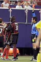 The MetroStars' Amado Guevara has to be restrained by teammate Tenywa Bonseu after being yellow carded for the second time in the game for dissent by referee Jair Marrufo. The resulting red card is the  MetroStars' first of the year. The MetroStars and the Columbus Crew played to a 1-1 tie at Giant's Stadium, East Rutherford, NJ on Sunday August 29, 2004.