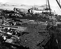 Supplies and equipment are also evacuated from the onslaught of the Communist Forces bearing down on Hungnam, Korea.  December 11, 1950.  Pfc. Emerich M. Christ. (Army)<br /> NARA FILE #:  111-SC-355021<br /> WAR & CONFLICT BOOK #:  1405