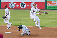 Wisconsin Timber Rattlers shortstop Jake Gatewood (2) turns a double play as Dorssys Paulino (17) slides in during a Midwest League game against the Lake County Captains on June 3rd, 2015 at Fox Cities Stadium in Appleton, Wisconsin. Wisconsin defeated Lake County 3-2. (Brad Krause/Four Seam Images)