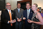 From left, Kirk V. Clausen, Gov. Brian Sandoval, Lt. Gov. Brian Krolicki and Danielle McVickers pose with their medallions at a ceremony marking the start of production of the fourth and final medallion in a commemorative Sesquicentennial series at the Nevada State Museum, in Carson City, Nev., on Wednesday, Sept. 3, 2014. <br /> Photo by Cathleen Allison