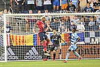 KANSAS CITY, KS - JULY 31: Nkosi Tafari #14 FC Dallas heads the ball during a game between FC Dallas and Sporting Kansas City at Children's Mercy Park on July 31, 2021 in Kansas City, Kansas.