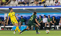 GRENOBLE, FRANCE - JUNE 18: Chantelle Swaby #4 of the Jamaican National Team passes the ball as Sam Kerr #20 of the Australian National Team pressures during a game between Jamaica and Australia at Stade des Alpes on June 18, 2019 in Grenoble, France.