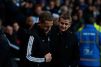 Saturday 2nd Febuaray 2014<br /> Pictured: Garry Monk, Manager of Swansea City shakes hands with Ole Gunnar Solskjaer, Manager of Cardiff City <br /> Re: Barclays Premier League Swansea City FC  v Cardiff City FC at the Liberty Stadium, Swansea