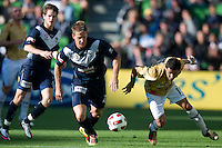 MELBOURNE, AUSTRALIA - DECEMBER 27: Adrian Leijer of the Victory and Ali Abbas of the Jets fight for the ball during the round 20 A-League match between the Melbourne Victory and the Newcastle Jets at AAMI Park on December 27, 2010 in Melbourne, Australia. (Photo by Sydney Low / Asterisk Images)