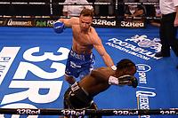 Felix Cash (blue shorts) defeats Denzel Bentley during a Boxing Show at York Hall on 24th April 2021
