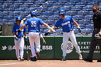 Memphis Tigers Taylor Howell (27) congratulates Hunter Goodman (35) after scoring a run during a game against the East Carolina Pirates on May 25, 2021 at BayCare Ballpark in Clearwater, Florida.  (Mike Janes/Four Seam Images)