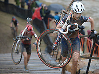 Clara Honsinger of Oregon carries her bicycle up stairs Wednesday, Oct. 13, 2021, as she competes in the Union Cycliste Internationale Cyclo-cross World Cup at Centennial Park in Fayetteville. The city was one of 16 sites around the globe to hold a world cup event this year for Union Cycliste Internationale, known as International Cycling Union in the United States. Fayetteville will host the UCI World Championships at Centennial Park Jan. 28-30. Visit nwaonline.com/211014Daily/ for today's photo gallery.<br /> (NWA Democrat-Gazette/Andy Shupe)