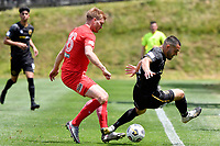 Hamish Watson of Team Wellington competes for the ball with Cory Mitchell of Canterbury United during the ISPS Handa Men's Premiership - Team Wellington v Canterbury Utd at David Farrington Park, Wellington on Saturday 19 December 2020.<br /> Copyright photo: Masanori Udagawa /  www.photosport.nz