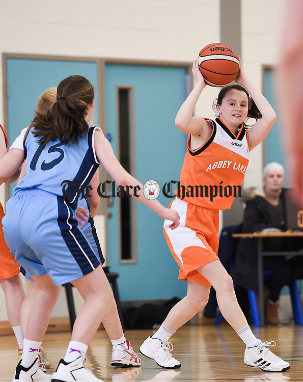 Rachel Begg of Abbey Lakers, Quin in action against Riana Byrne of Blue Stars, Cooraclare during their U-16 girls county final in Ennis National School sports hall. Photograph by John Kelly.
