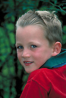 Portrait of a smiling blonde boy in red shirt (close-up.). Claudius. Germany.