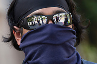 Demonstrators are reflected in the sunglasses of a police officer near the White House in Washington D.C., U.S., on Tuesday, June 23, 2020.  Trump tweeted that he authorized the Federal government to arrest any demonstrator caught vandalizing U.S. monuments, with a punishment of up to 10 years in prison.  Credit: Stefani Reynolds / CNP/AdMedia