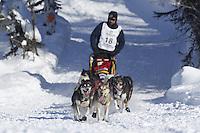 Sunday, March 4, 2012  Lance Mackey drops onto Long Lake at the restart of Iditarod 2012 in Willow, Alaska.