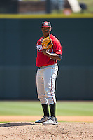 Carolina Mudcats relief pitcher Mauricio Cabrera (22) looks to his catcher for the sign against the Winston-Salem Dash at BB&T Ballpark on April 22, 2015 in Winston-Salem, North Carolina.  The Dash defeated the Mudcats 4-2..  (Brian Westerholt/Four Seam Images)