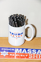 A Trump 2020 campaign mug filled with pens stands on a desk in the office of the New Hampshire Republican State Committee in Concord, New Hampshire, on Wed., Sept. 16, 2020.
