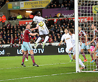 Pictured: Bafetimbi Gomis of Swansea (C) scoring his equaliser Saturday 10 January 2015<br /> Re: Barclays Premier League, Swansea City FC v West Ham United at the Liberty Stadium, south Wales, UK