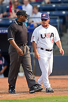 USA Manager Tim Jamieson #9 (Missouri) talks to the first base umpire during the game against the Japan Collegiate National Team at the Durham Bulls Athletic Park on July 3, 2011 in Durham, North Carolina.  USA defeated Japan 7-6.  (Brian Westerholt / Four Seam Images)