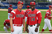 Batavia Muckdogs coaches Steven Suarez (7) and Rigoberto Silverio (18) after the team photo on July 8, 2015 at Dwyer Stadium in Batavia, New York.  (Mike Janes/Four Seam Images)