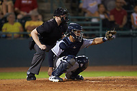 Charleston RiverDogs catcher Eduardo Navas (20) frames a pitch as home plate umpire Mitch Leikam looks on during the game against the Hickory Crawdads at L.P. Frans Stadium on August 10, 2019 in Hickory, North Carolina. The RiverDogs defeated the Crawdads 10-9. (Brian Westerholt/Four Seam Images)