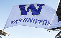 Cheerleaders fly a Washington flag following a score.