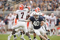 "State College, PA - October 21, 2006:  Penn State linebacker Dan Connor (40) attempts to tackle Illinois quarterback Isiah ""Juice"" Williams (7) during the game against Illinois at Beaver Stadium on October 21, 2006, in State College, PA.  Penn State defeated Illinois by a score of 26-12.  (PHOTO BY: Joe Rokita / JoeRokita.com)"