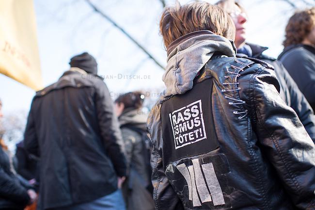 """Rally against fashism at the 13th February 2015 in Dresden.<br /> 2.000 people took place on a march trough Dresden to visit places of interest to explain what happens in the decade of national socialism in Dresden.<br /> Here: A boy with a sticker """"Racism kills"""".<br /> 13.2.2015, Dresden<br /> Copyright: Christian-Ditsch.de<br /> [Inhaltsveraendernde Manipulation des Fotos nur nach ausdruecklicher Genehmigung des Fotografen. Vereinbarungen ueber Abtretung von Persoenlichkeitsrechten/Model Release der abgebildeten Person/Personen liegen nicht vor. NO MODEL RELEASE! Nur fuer Redaktionelle Zwecke. Don't publish without copyright Christian-Ditsch.de, Veroeffentlichung nur mit Fotografennennung, sowie gegen Honorar, MwSt. und Beleg. Konto: I N G - D i B a, IBAN DE58500105175400192269, BIC INGDDEFFXXX, Kontakt: post@christian-ditsch.de<br /> Bei der Bearbeitung der Dateiinformationen darf die Urheberkennzeichnung in den EXIF- und  IPTC-Daten nicht entfernt werden, diese sind in digitalen Medien nach §95c UrhG rechtlich geschuetzt. Der Urhebervermerk wird gemaess §13 UrhG verlangt.]"""