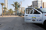 A car of the municipal utilities stop by the road, during the lockdown imposed by the authorities in a bid to slow the spread of the coronavirus, in Beirut, Lebanon, on January 7, 2021. Since the start of the Covid-19 pandemic, Lebanon has recorded nearly 200,000 cases including 1,537 deaths, according to health ministry figures. Health professionals have warned that the latest surge in cases risked causing catastrophe across Lebanon, which is already suffering from the aftermath of a devastating August explosion in Beirut and a dire economic crisis. Photo by Marwan Bou Haidar