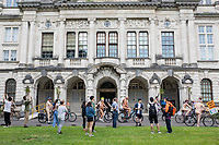 People prepare to leave Cardiff University main building at the start of the Cardiff World Naked Bike Ride, 25 July 2021. The bike ride aims to highlight the vulnerability of cyclists against traffic in cities, with the human body presented as a contrast to high powered vehicles. Photo by Mark Hawkins.