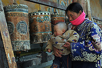 A Tibetan amd prayer wheels at Xia Qiong Temple, Qinghai, China. Qinghai Province in western China borders Tibet and parts were the scenes of disturbance earlier this year, 2008..12 Nov 2008