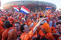 Netherlands fans gather before The 2010 FIFA World Cup Final between Spain and Holland outside Soccer City in Soweto, South Africa on Sunday, July 11, 2010.  Spain defeated Netherlands 1-0.