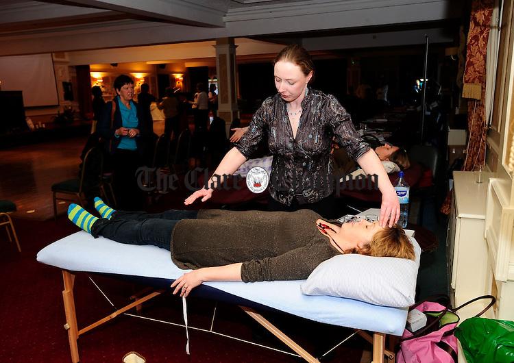 Kinesiologist Jean Kavanagh treats Elaine Dalton during Womens International Day celebrations at the Auburn lodge Hotel.Pic Arthur Ellis.