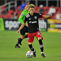 WASHINGTON, DC - JULY 7: Griffin Yow #22 of D.C. United  moves the ball during a game between Liga Deportiva Alajuense  and D.C. United at Audi Field on July 7, 2021 in Washington, DC.