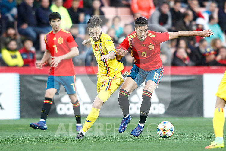 Spain's Carlos Soler , Spain's Mikel Merino and Romania's Ciobanu Andre  during the International Friendly match on 21th March, 2019 in Granada, Spain. (ALTERPHOTOS/Alconada)