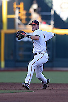 Branden Cogswell #7 of the Virginia Cavaliers throws during Game 4 of the 2014 Men's College World Series between the Virginia Cavaliers and Ole Miss Rebels at TD Ameritrade Park on June 15, 2014 in Omaha, Nebraska. (Brace Hemmelgarn/Four Seam Images)