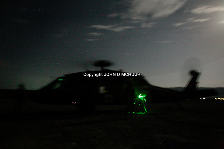 """A Medevac helicopter from the 101st Aviation Regiment refuels after a rescue mission at night in Paktika province, Afghanistan, 21 July, 2008. Also known by their call sign """"Dust Off"""","""" the Medevac pilots, crew and medics are ready to fly at a moments notice, picking up Coalition soldiers as well as Afghans that require help.(John D McHugh)"""